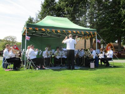 Band playing in marquee at Bellingham campsite